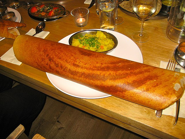 """Paper Masala Dosa"" by SteveR- - http://www.flickr.com/photos/git/3936135033/. Licensed under Creative Commons Attribution 2.0 via Wikimedia Commons"